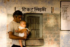 The rustic backdrop (niyatee) Tags: india station rural booth women village railway ticket haryana