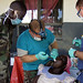 Dental work: Extract a bad tooth from a patient at Palabek Kal Health Centre - Natural Fire 10 - US Army Africa - 091019