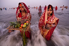 Waves of faith (Ashish T) Tags: ocean sea woman india men water colors festival night canon lowlight women worship colorful god o indian religion tokina celebrations tradition mumbai hindu hinduism puja prayers 1224 rituals chhath 40d socialaffairs ashishtibrewal