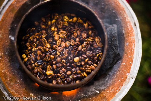Fresh Ethiopian coffee is roasted over a small charcoal brazier.