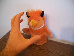 The creepy hand is coming to get Helix! (helixdmonster) Tags: orange monster puppets cpm helix handpuppets creepyhands monsterhandpuppets helixdmonster