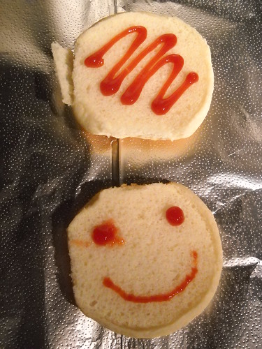 Who says making a hamburger cant be a fun experience. Happy ketchup smiles!