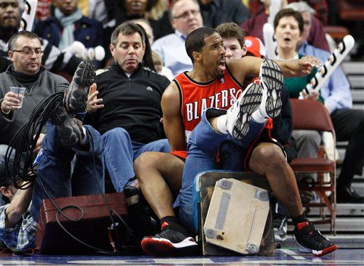 20100120-andre-miller-wipes-out-tv-crew