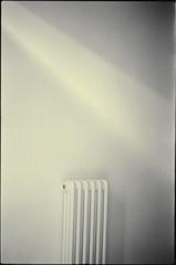 Termosifone mistico - Mystic radiator (Blackeyedog) Tags: light shadow bw film analog 50mm pentax ombra nowhere spotmatic nothing radiator luce umbria interno termosifone pellicola niente fomapan id11 nocera umbra revuenon