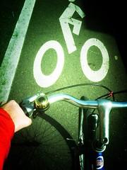 Bikelane stencilman (Ben McLeod) Tags: cameraphone bike oregon portland pdx handlebar bikelane bikebyshooting breezer iphone bikelanestencil fromthebike swankolab