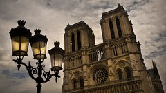 The Smile of Notre-Dame (Gilderic Photography) Tags: street light sky cloud cinema paris france tower art history church lamp smile stone architecture lumix funny iron europe raw mood cathedral gothic humor humour notredame panasonic story ciel lumiere sacred histoire nuage cinematic sourire lampadaire fer cathedrale lightroom amusant superaplus aplusphoto lx3 dmclx3
