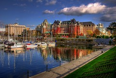 Victoria, British Columbia (Brandon Godfrey) Tags: world pictures city blue autumn sky urban cloud canada color colour reflection building bus green fall water colors grass architecture clouds marina buildings reflections boats photography sussex daylight amazing colorful downtown day cityscape colours bc view photos harbour pics earth britishcolumbia postcard sony awesome scenic bluesky scene victoria canadian clear vancouverisland creativecommons pacificnorthwest northamerica colourful alpha dslr puffy hdr highdynamicrange doubledecker causeway innerharbour a300 thebelvedere fairmontempress theempresshotel tonemapped tonemapping theastoria cityofgardens sonya300 thearia thebelmontbuilding