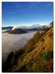 Hidden Volcanoes (Nora Carol) Tags: clouds indonesia volcanoes surabaya bromo active fogs eastjava malaysianphotographer theunforgettablepictures noracarol sabahanphotographer landscapephotographerfromsabah womanlandscapephotographer womaninphotography