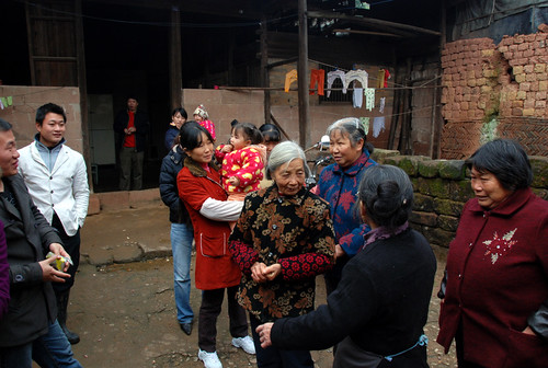 Some of the family and villagers who turned out to see Na Fei