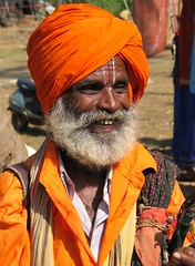 Another Anjuna Sage. (konstantynowicz) Tags: old portrait orange india face beard interesting asia market character goa sunny sage elder anjuna aged colourful turban mygearandmepremium mygearandmebronze mygearandmesilver soulopeople2 soulopeople3 soulopeople4