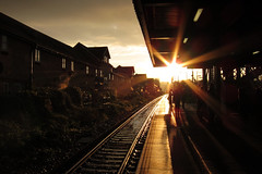 before the snow... (MrLomo) Tags: morning light sun station digital train early bright dailycommute flare commuters grovepark canons90