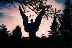 Sun Sets on the Outspread Wings of the Concrete Angel (Madison Guy) Tags: sculpture art wisconsin folkart outsiderart phillips selftaught vernacular foundobjects wi olympusxa expressionistic kodakgold200 fredsmith wisconsinconcretepark digitizedwithnikoncoolpix