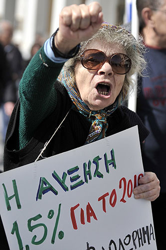 Woman protests austerity cuts in Greece