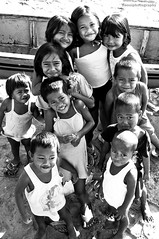 faces of hope and dreams (nonoiphotography (post and run mode)) Tags: poverty blackandwhite kids children philippines smiles innocence bicol ignorance sorsogon hopeanddreams gubatsorsogon putingbaybay baluddelsur childrengroupshot