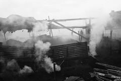 smoked (jobarracuda) Tags: lumix smoke manila worker fz50 tondo uling panasoniclumixdmcfz50 jobarracuda charcoalmaking jojopensica pensica ulingan charcoalmaker