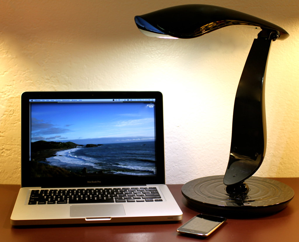 iphone 5, Macbook Pro, and a Beacon 600 by IMG Lighting Lamp
