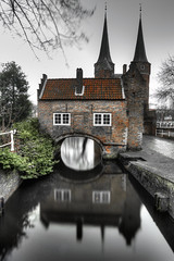 East Gate - Reflection (Rik Tiggelhoven Travel Photography) Tags: oostpoort east gate delft nederland netherlands holland building architecture medieval reflection long exposure hdr selective color canon 6d fullframe ef1740mmf4lusm rik tiggelhoven travel photography brick gothic europe europa gallery water nd filter neutral density fader longexposure ndfilter