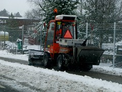 a snow plow clears a bike lane in Copenhagen, Denmark
