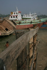 Ships on All Sides (ellievanhoutte) Tags: poverty travel people industry water work canon workers labor ships working rivers canon5d bangladesh developingcountry khulna