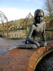 Julia (magnuscanis) Tags: sculpture girl bronze garden pond 34 rhs rosemoor a480 20091228