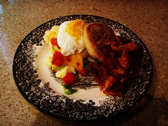 scrambled eggs with biscuit and bacon and fresh salsa