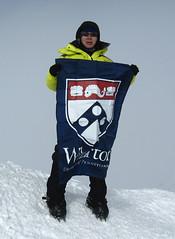 Lei Wang, WG03, flying the Wharton banner atop Antarcticas Vinson Massif.