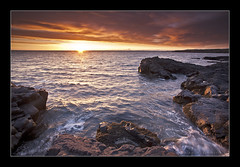 Sunset in Iceland (Arnar Bergur) Tags: ocean sunset sea sky orange water clouds sunrise canon landscape iceland rocks stones horizon 5d arnar 1740 sland islande calp hvaleyri visipix arnarbergur