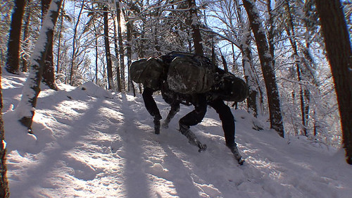 BigDog is a rough-terrain robot that walks, runs, climbs and carries heavy loads. It is powered by an engine that drives a hydraulic actuation system and has four legs that are articulated like an animal's with compliant elements to absorb shock and recycle energy from one step to the next. (BigDog image provided courtesy of Boston Dynamics ©2009.)