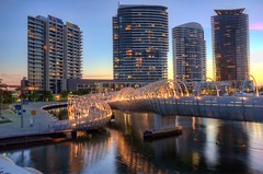 Docklands & Webb Bridge (J-C-M) Tags: bridge sunset urban reflection water architecture photoshop buildings lights nikon dusk bracket d70s australia melbourne victoria docklands hdr topaz webbbridge 3xp photomatix tonemapped melbournearchitecture