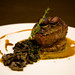 Grilled beef tenderloin with truffle oil potatoes cake in mushrooms saute