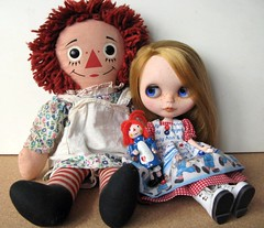 Raggedy Ann and Raggedy Abby and a little mini-raggedy ann