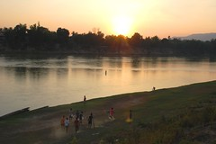 playing ktw until dark, Attapeu (aquanica) Tags: sunset laos motobike attapeu bolaven sekongriver ktw