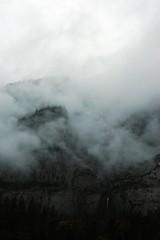 A waterfall peeks through clouds, with the mountain cuddled up in fuzzy white, Yosemite National Park, California, USA (Wonderlane) Tags: california usa clouds waterfall yosemitenationalpark through peeks 6541 wonderlane awaterfallpeeksthroughclouds withthemountaincuddledupinfuzzywhite