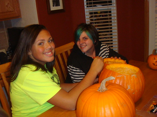 Taylor and Kayley carving their pumpkins!