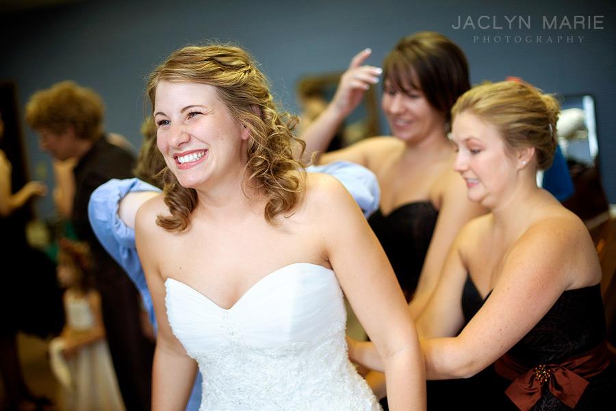 putting on wedding dress photo