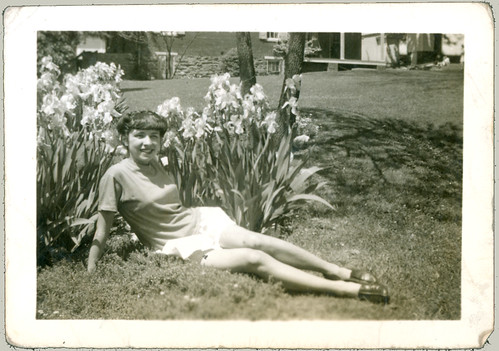 Girl on grass with iris