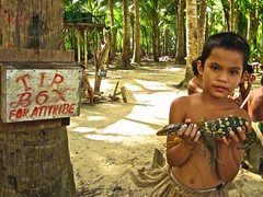 boy with his monitor lizard