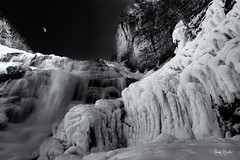 like starlight into day ([Adam Baker]) Tags: winter bw moon snow ny ice monochrome canon frozen waterfall upstate moonrise cny icicle ithaca fingerlakes cascade cpl fallcreek ithacafalls 1740l adambaker 5dmarkii