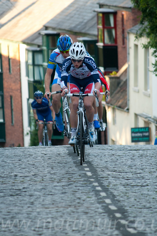 Riders cresting the brow of the steepest section of the tough durham course