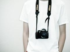 Simple (Ichikasuto) Tags: camera white self neck nikon body portait tshirt cap strap simple showing plain d3100