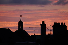 bell tower in evening 22 o'clock 15.06.11 1 (jean matthieu) Tags: pink roof light sunset summer vacation chimney sky urban cloud sun france color bird tower art church sunshine birds architecture clouds canon landscape geotagged photography evening soleil photo spring europe tour view bell photos lumire pigeon corneille belltower roofs ciel nancy cupola dome parma fowl crow soire patsy nuage soir raven toit lorraine ruff couleur coucherdesoleil urbanlandscape chemine volatile corbeau panoramicview stnicolaschurch meurtheetmoselle blackraven glisestnicolas