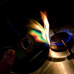 """"""" Is that the support desk? I'm having trouble burning a disc... (photocillin) Tags: toxic kitchen square fire dvd rainbow melting cd gas plastic burning flame burn disk stove heat melt cooker disc rom fumes notaeater"""