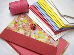chiyogami cover, construction paper, fuschia thread and a ladybug