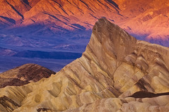 Zabriskie Point Sunrise - Death Valley National Park, California (Jim Patterson Photography) Tags: california longexposure travel light mountains color nature sunrise landscape gold dawn golden rocks colorful desert natural scenic rocky structure erosion vista polarizer zabriskiepoint gitzo daybreak formations reallyrightstuff deathvalleynationalpark remoterelease inyocounty manleypeak amargosarange nikkor70200mm goldnblue nikond300 markinsm20ballhead erosional jimpattersonphotography jimpattersonphotographycom seatosummitworkshops seatosummitworkshopscom