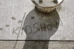 Kidshow with a Smile (Generik11) Tags: sf graffiti shadows faces cement foundinsf sfist gwsf gwsf5party gwsflexicon