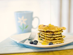 Pancake Day (Stuart Stevenson) Tags: cup kitchen 50mm 14 plate fork blueberry homemade messy canon350d athome pancake pancakeday shrovetuesday goldensyrup borrowedcam butgood stuartstevenson pouringsyrupfromagreatheight