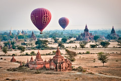 Balloons over Bagan (samthe8th) Tags: travel history fairytale balloons landscape pagoda ancient sam burma accepted1of100 hotair balloon dream indigo explore hero temples winner hotairballoon myanmar paya greenlantern magical frontpage enchantment pagan pagodas bagan topaz trav