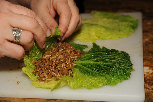 Rolling stuffing into cabbage leaves