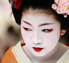 face / portrait / people / girl / red lips / make up : maiko (geisha apprentice) kyoto, japan / canon 7d (momoyama) Tags: travel red portrait people orange girl face japan canon asian japanese kyoto asia traditional culture makeup 85mm lips maiko geiko geisha 7d   2010 baikasai ef85mmf18  kamishichiken  plumblossomfestival  naokazu