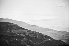 Remains Of A Dead Sea.. (SonOfJordan) Tags: sea blackandwhite bw mountains nature water contrast canon landscape dead eos blackwhite high mood noiretblanc jordan hazy deadsea faint xsi gradual 450d  samawi sonofjordan shadisamawi  wwwshadisamawicom